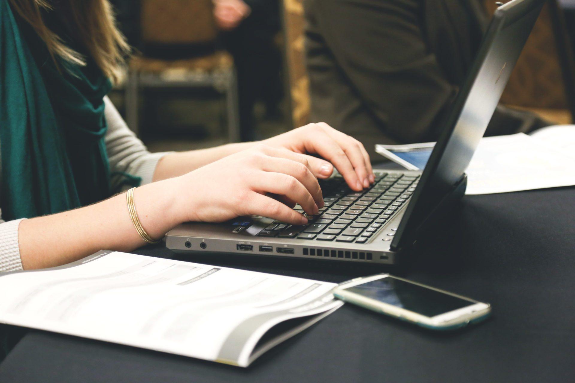 woman-typing-laptop-e1467790731955